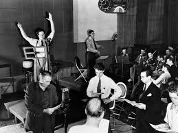 the infamous war of the worlds radio broadcast was a magnificent  orson welles arms raised rehearses his radio depiction of h g wells classic the war of the worlds the broadcast which aired on 30 1938