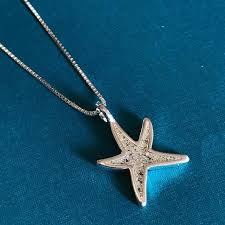 s u n d a y sterling silver delicate starfish filled with sand from maho bay in saint john usvi sterlingsilver wearyourtravels mahobay