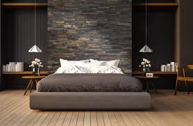 reclaimed wood accent wall behind bed