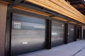 aluminum garage doors accent the home with a modern touch and can be fully customized to meet your specific needs