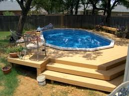 above ground swimming pool with deck.  Swimming Above Ground Swimming Pool Decking With Deck Oval  Ideas Decks Plans Free On G