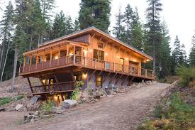 off the grid home design. small rustic three-story wood exterior home idea in seattle with a shed roof off the grid design t