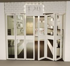 option 1 white framed bi fold door with clear glass panes lockable