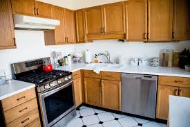 painting wood kitchen cabinetsHow to Paint Wood Kitchen Cabinets  Girl Nesting