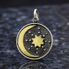 sterling silver talisman charm with bronze sun moon