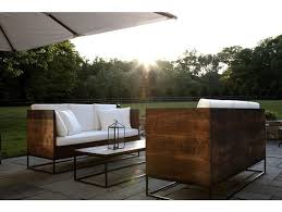 modern outdoor furniture Awesome sectional outdoor sofa Chic patio boasts a pair of reclaimed wood outdoor sofas with high backs lined with white cushions facing each other across from a stone top cof