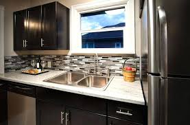 backsplash for dark cabinets compact contemporary kitchen with dark cabinets light granite counter and black and