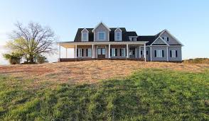 this version of the low country farmhouse plan from alan mascord is located outside of raleigh nc the farmhouse is 2 622 with 4 bedrooms 3 5 bathrooms