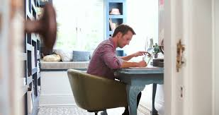 working for home office. view through door showing man working in home office 4k stock footage clip for