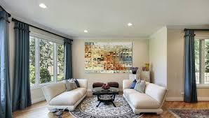 round rug white sofas long blue curtains living room