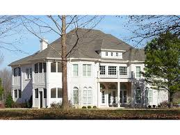 luxurious and grand stucco two story home with european influence