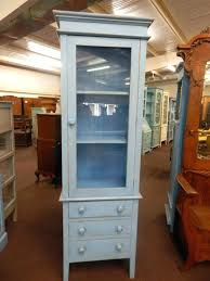 winsome alps tall cabinet with glass door and drawer tall cabinet with glass doors breathtaking corner