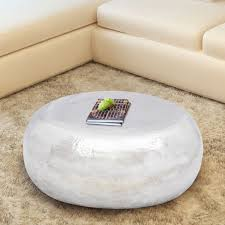 round hammered aluminium coffee table in silver living room