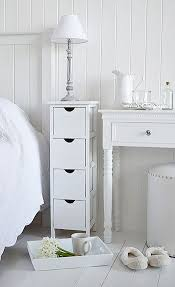 White narrow bedside table with four drawers. Perfect for when there is  little space in