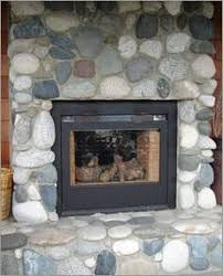 installing river rock to your fireplace surround is a moderately simple do it yourself project