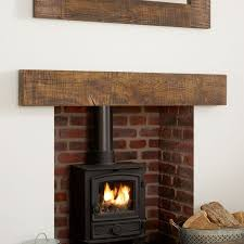 about the grosvenor solid oak beam mantel the grosvenor beam mantel is styled from deep sawn solid oak beams and treated with a dark tudor wax and