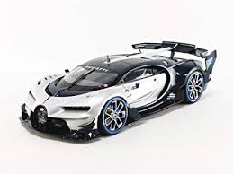 An exposed carbon fiber tail finish, a carbon fiber finish on the c that is typically finished in aluminum and a 16 featured on the grille mesh top the list of exterior modifications. Amazon Com Bugatti Vision Gran Turismo 16 Argent Silver And Blue Carbon Fiber 1 18 Model Car By Autoart 70987 Toys Games