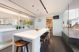 dining table in the kitchen of modern mansion in miami amazing lighting