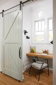 Image Dining Room Small Home Office With Green Barn Door On Rails Decorpad Small Home Office With Green Barn Door On Rails Transitional Den