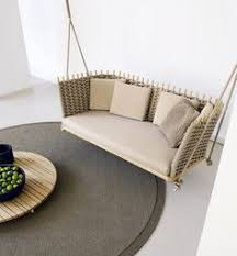 wooden garden swing seat wabi collection by paola lenti