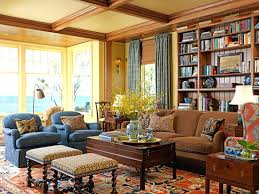 tan living room furniture carpeted floor wooden desk twisted leg stools tan sofa blue couch yellow