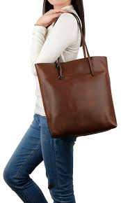 a roomy tote with a distressed finish that ll fit your laptop and notebooks while keeping its shape
