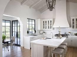 all white kitchen design with wrought iron lantern style pendant