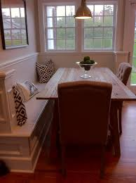 corner bench with dining table. this could be perfect as a half wall in our dining  room space, and would allow for an open kitchen.