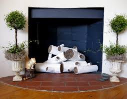 diy cardboard faux logs by brenna i have always adored a fireplace in the living room nothing beats the warm in more ways than one feeling that it