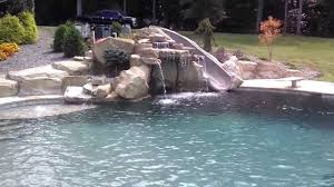 inground pools with waterfalls and slides. Uncategorized Rock Pool Slides For Inground Pools Inspiring Charlotte Cool Waterfallslide Grotto Design By Creative With Waterfalls And L