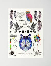 татуировка с перьями птицами и волком