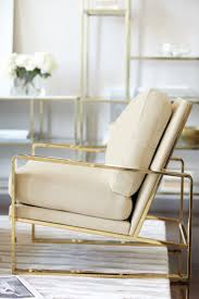 Bernhardt Interiors | Dorwin Chair, polished brass finish, shown in ivory  leather | Jet