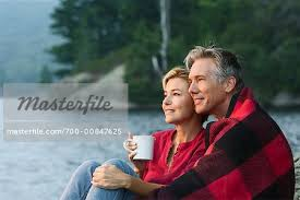 Couple Sitting Beside Lake - Stock Photo - Masterfile - Rights-Managed,  Artist: Marc Vaughn, Code: 700-00847625