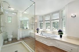 Master Bath Design Ideas spacious contemporary white luxury bathroom with tub by bay window and glass shower