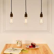 a trio of bare bulb pendants