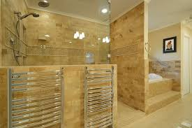 two towel rails on the outstide of a shower and bath in a marble style bathroom