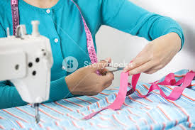 Image result for image of a tailor cutting fabrics