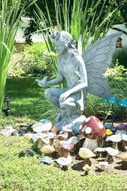 large fairy statues garden fairy statue garden fairies a large fairy keeps watch over a village large fairy statues fairy garden