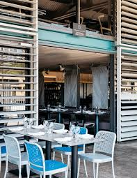 Kingsleys woolloomooloo wharf sydney harbour outdoor seating with de padova silver chairs