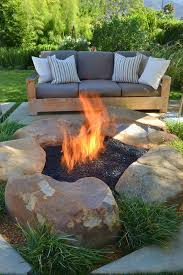 This fire pit is rustic and different. They basically used large rocks and  dirt to Build this fire pit  It might be a little more on the expensive  side ...