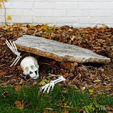 ideas outdoor halloween pinterest decorations: pieces of a plastic skeleton make a creepy entrance in this simple outdoor halloween daccor idea