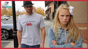 Dad and teen girl
