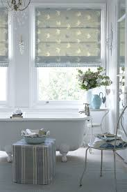 bathroom blinds. roman blind in vanessa arbuthnott swallow dive duck egg and speedwell with a leading edge little leaf forgetmenot denim bathroom blinds