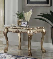 dresden coffee table in gold patina finish by acme 82090