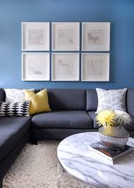 charcoal gray sectional with yellow pillow
