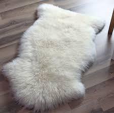 ivory faux sheepskin rug on wooden floor for pretty decoration ideas bear skin with head ikea area fur fake sheepski white decorating round accessories