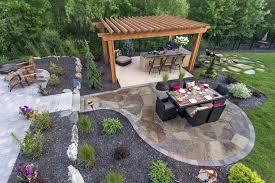 patio design images outdoor stone dining patio next to an outdoor bar under a pergola metro patio design