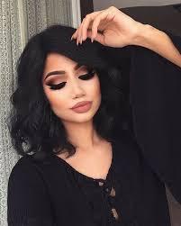 black dress black curls and an amazing make up