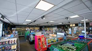 lighting to go. philips gas station lighting products cover the ceiling of q8 qvik to go store