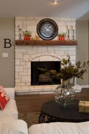renovated texas limestone fireplace with wood mantel